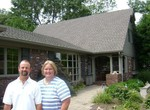 Bill and Marsha in front of our current home.